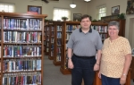 Librarian Robert Neuenschwander (left) and Assistant Susan Mills make up the whole of the staff of the Warren Public Library, which is celebrating its 100th anniversary this weekend.