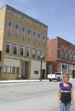 Gina Canady, who along with her husband Scott owns a building at 115 N. Wayne St., Warren, stands across the street from the structure which was granted a 2010 Facade Grant.