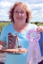 Donna Waters displays the leather sculpture that won her a reserve grand champion ribbon at the Indiana State Fair.