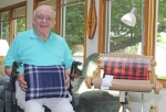 William Bowman, of Markle, holds the pillow he created for the Huntington County 4-H Fair's open class next to the loom he made it on. Entering something in the 4-H Fair fulfilled a lifelong goal for Bowman, who recently turned 90.