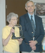 Ruth Weber accepts a plaque from Steve Schenkel, director of the Huntington County Community Schools' adult education program, during a reception on Thursday, May 27 honoring Weber on her retirement from a 51-year teaching career.