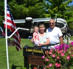 Salamonie Lake campground hosts Brenda (center) and Ron Werling, of Ossian, receive a visit from 1-year-old granddaughter Addison Girardot (left) on Friday, Aug. 21. The couple — he's retired, she's not — are part of a Department of Natural Resources program that offers a free stay in exchange for helping out at the campground a few hours a day.