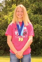 Addy Wiley, a freshman at Huntington North High School, wears the medals she won at the Indiana Girls' Track and Field State Meet on Saturday, June 1, at Indiana University, in Bloomington. Wiley won the 1,600-meter run and placed seventh in the 800-meter run.