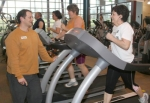 Parkview Huntington YMCA Fitness Director Todd Latta talks to Teresa Wright (center) and Kathy Scott during their workout time at the YMCA. Latta says exercise is the key to maintaining a healthy lifestyle.