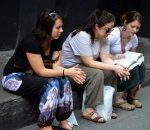 Angela Mills (center) prays outside of a church in Thailand with fellow missionaries Julie Schell (left) and Katy Collins.