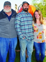 Wayne Rader (from left) and his daughter and son-in-law, Ryan and Katelyn Shuttleworth, are the second and third generations of the Rader family to sell produce in Huntington County.