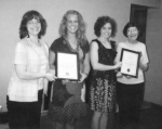 Cindy Rice (left) and Shirley Schug (right), co-chairmen of the ABWA Kilsoquah Chapter scholarship committee, present scholarships to Brittany Smalling (second from left) and Alison Spahr (third from left).