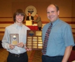 Huntington North High School student Taylor Allred and chemistry teacher Joe Perkins display Allred's first-place trophy from the Northeaster Indiana American Chemical Society competition.