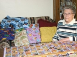 Betty Leininger talks about her yarn-tied quilting hobby, which she does at her rural Yoder home, on Friday, March 6. At 85, she started making the blankets just a little over a year ago and has already made over 100.