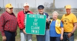 Shown with one of the signs the Andrews Lions Club had made to recognize the accomplishments of the Clark twins are (from left) Lion Phil Bitzer, Joe Clark, Dale Clark, Lions President Joyce Walker and Lion Phil Ruppert.