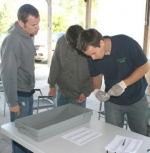 Sorting prescription drugs during Drug Drop Off Day on Saturday, May 30, at Hier's Park are (from left) Scott Haskett, Kenneth Field and Jonathan Leist, the latter the director of the Huntington County Solid Waste District.