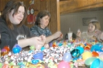 Huntington Jaycees members (from left) Melissa McElhaney and Diane Pinkerton get some help from Jessica Molitor on Monday, March 23, as they stuff plastic eggs with candy for use in the Jaycees' April 4 Easter Egg Hunt at Memorial Park.