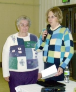 Joenita Keller (left) receives the Friends of Extension Award from Janell Brubaker during the Huntington County Extension Service's annual dinner meeting on Thursday, Feb. 19.