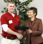 Jamon Hammel (left) is congratulated by Huntington University Interim President Ann McPherren after receiving an HU Presidential Scholarship and a Coloquium Scholarship.