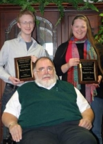 Huntington University students (back from left) Matthew Schownir and Elizabeth Holtrop are the recipients of two HU history honors given recently, including the award named for Professor Emeritus Jack P. Barlow Sr. (seated).