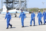 Lee Archambault, commander of space shuttle Discovery (left), leads several of the astronauts across the tarmac upon their arrival at Cape Canaveral  earlier this week.