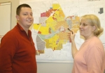 Bryn Keplinger (left), assistant director of the Huntington Countywide Department of Community Development, and Marla Stambazze, the DCD's subdivision coordinator, point out the area in Huntington that will be surveyed April 18.