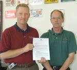 Dave Niswander (left) and Sam Niswander, co-owners of H.H. Niswander in Huntington, display the letter they received from General Motors, informing them that their dealership would be allowed to stay in business, selling GM's Buick and GMC Truck lines.
