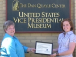 Margie Hedrick (left), first vice president and education chair of the Dan Quayle Commemorative Foundation, presents the foundation's scholarship to Alison Spahr.