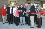 Brick House Grill owners Andrew Sprinkle and Garin Stephan (front, fourth and fith from left) cut the ribbon to open their new restaurant at 19 W. Washington St., Huntington, on Thursday, April 16.