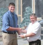 Zach Sovine (left) receives the Roanoke Chamber of Commerce Scholarship from Roanoke Chamber President Mike Gibson.
