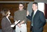 Bryn Keplinger (right) is sworn in Monday, March 30, as assistant director of the Huntington Countywide Department of Community Development by Huntington Clerk-Treasurer Christi Scher (left) . DCD Department Director Nate Schacht observes.