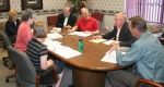 Members of the 2009 United Way Campaign Cabinet discuss plans for the upcoming United Way fund drive on Thursday, June 11, at First Federal Savings Bank.