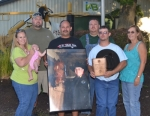 The family of the late Phil Kreider poses with a photo of their husband and father after Kreider was named 2017 Outstanding 4-H Leader Monday evening, July 24, at the Huntington County Fairgrounds. Family members are (front from left), Kreider's daughter, Keturah Hyde, holding his granddaughter, Ember Hyde; Kreider's sons, Chad Kreider (holding photo) and Lance Kreider; and Kreider's widow, Denise Kreider; and (back from left), Kreider's son-in-law, Eddie Hyde, and son, Ryan Kreider.