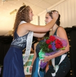 Larissa Johnson (left) 2017 Huntington County 4-H Royalty Champion, crowns her successor, Josi Barscz, Friday night, July 13, at the Huntington County 4-H Fair Royalty Contest at First Merchants Bank Heritage Hall at the Huntington County Fairgrounds.