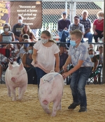 Aubrey Miller and Kolton Smart show their pigs during the 4-H Swine Show on Monday, July 27.