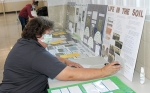 Teresa Rody, of LaFontaine, judges a soil and water project entered in the Huntington County 4-H Fair on Thursday, July 23.