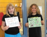 """Andrews Elementary School students Jadynn Giedeman (left) and Gavin Price submitted the winning entries in the Andrews Summer Festival """"Design the 2014 Logo"""" contest."""