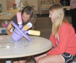 Hannah Landrum, right, speaks with basic crafts Judge Tami Mosier, of Steuben County, about her lamp during project judging at Lincoln Elementary on Thursday, July 22.