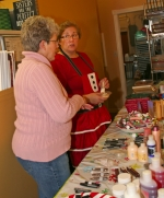 """Earlynn Worster (left), of Markle, discusses products for sale with Nadean Brown in Nadean's Bake Shop in downtown Markle during the 2014 Christmas in """"Our Town"""" celebration. This year's event will be held on Dec. 5 and 6."""