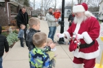 Santa Claus hands out candy canes to brothers (from front) Brant Perl, Blake Perl and Chase Perl during the Christmas in Our Town event last year in Markle. This year's event will be held Saturday, Dec. 2.