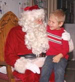 An excited Elias Adkins tells Santa Claus what he wants for Christmas last year at the Markle Fire Station during Markle's annual Christmas celebration, Christmas in Our Town. This year's event happens Friday, Dec. 6, and Saturday, Dec. 7.