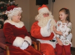 Kaytlin Barry (right), 7, of Roanoke, gets a high-five from Santa Claus for being a good girl during the past year, as Mrs. Claus watches during Breakfast with Santa at Cornerstone Alliance Church last year. The church will again hold the event as part of Roanoke's Christmas in the Village celebration, on Saturday, Dec. 7.