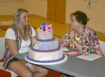 Paige Widener (left) and Judge Sharon Hunt, of Auburn, discuss Widener's cake decorating work during 2010 4-H fair project judging on Thursday, July 22.