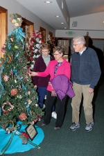 Nancy Nethercott (middle), along with Ann Ericsson (left) and Dwight Ericsson, admires a Christmas tree decorated by the Master Gardeners of Huntington County during Christmas at the Forks, held at the Forks of the Wabash Historic Park, in Huntington, on Saturday, Dec. 3. Several elaborately decorated trees and wreaths were on display at the park and attendees got to vote on their favorites. At the end of the day on Sunday, Dec. 4, one vote was drawn for each entry and the person who cast that vote was awarded the tree or wreath.