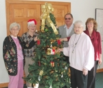 Members of the Kilsoquah Hands of Friendship Club gather to add decorations to one of the trees that will be featured in the Historic Forks of the Wabash Christmas Tree Walk, set for Dec. 5 and 6. Pictured are (front, from left) Janet Perkins and Shirley Brown; and (back, from left) Carol Strickler, Dale Rice and Cindy Rice of Deal-Rice Funeral Home, the sponsors of the tree.