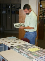 Judge Loren Schaefer reviews geology projects during 2010 4-H fair exhibit judging on Thursday, July 22.