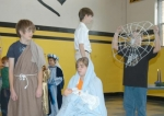 Kris Dunn (standing at left) and Emily Klepper (seated) portrayed Joseph and Mary in a short play presented by Huntington Catholic School students during an Advent service on Thursday, Dec. 17.