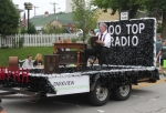 "With Mike Perkins doing the broadcasting 1930's style, the Parkview Huntington Hospital float heads down the Huntington Heritage Days Parade route on Saturday morning, June 20. The float was judged best theme float, with the theme being ""Broadcasting the 1930s."""
