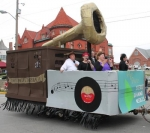 Christian Life Tabernacle Church members come down the Huntington Heritage Days Parade route on North Jefferson Street with their float decorated as a 1920s-era Victrola on Saturday morning, June 21.