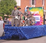 """This theme float parade entry by First Federal Savings Bank highlights The Beatles as it makes its way down the Huntigton Heritage Days Parade route on Saturday, morning, June 22. The festival theme was """"The '60s: 'Yesterday.'"""""""