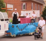 New Life Ministries' float proceeds down Warren Street, in Huntington, as part of the 55th annual Heritage Days Parade on Saturday, June 23. The float was designed to look like a soda shop from the 1950s, which was the decade that was highlighted at this year's festival.