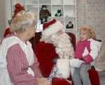 Madison Wajer visits with Santa and Mrs. Claus during their visit to Huntington during the 2008 Christmas in the City event. Santa will arrive in Huntington this year on Saturday, Nov. 28.
