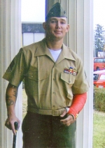 Marine Sergeant Robbie Holzinger was awarded the Purple Heart on Nov. 15, 2006, after he was injured by an improvised explosive device in Anah, Iraq.