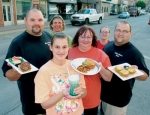 Participating vendors in JeFFFest on Sunday, June 20, hold samples of the food they plan to prepare for the event, to be held in downtown Huntington.