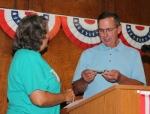 2018 Samuel Jones Pioneer Award winner Jeff Souder (right) accepts the key to Warren from Warren Town Council Member Julia Glessner during the annual Pioneer Breakfast held Friday, June 29, at the Knight Bergman Center. Souder, who owns the East of Chicago Pizza in Warren, also received a plaque as the town's 30th person to receive the accolade.